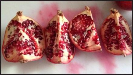 Cut the pomegranate in half and then cut each piece until you have four pieces.